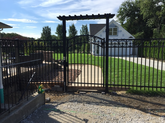 Arched Ornamental Iron Gate with Access Control & Custom Pergola