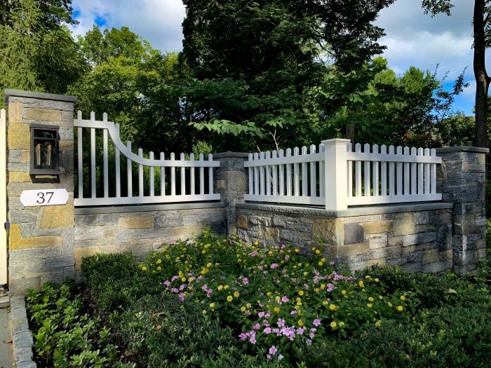 Azek Picket Fence on Stone Wall