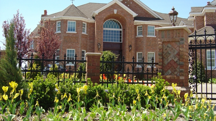 Estate Fence Across Front Yard with Brick Columns.