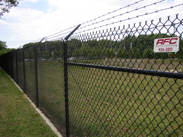 Black Commercial Chain Link Fencing with Barbed Wire